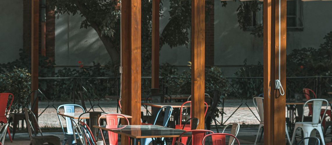 Paul-Voie_tables-and-chairs-under-canopy